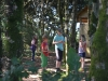 Chidren playing in the woodland at Denmark Farm Eco Campsite