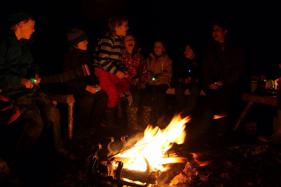 Telling stories around the campfire after dark