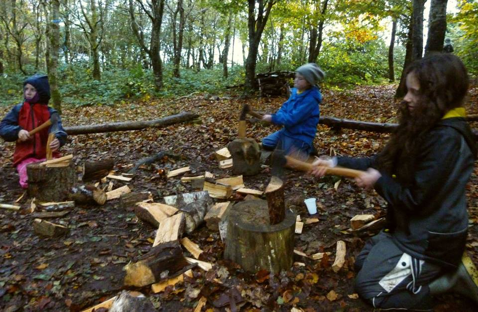 Practising cutting firewood with an axe